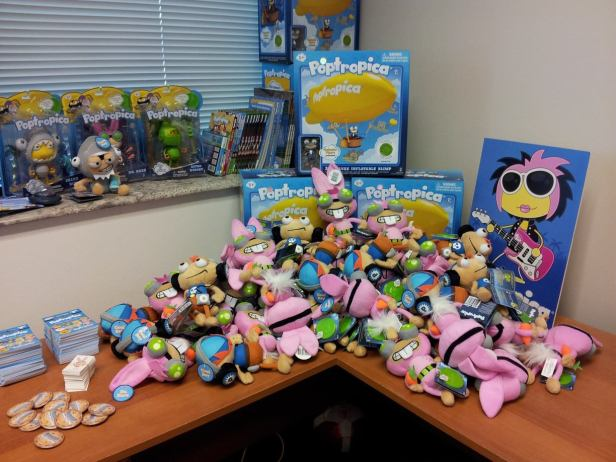 Some of our Poptropica merchandise hanging around our office. Now we just need to build a ball pit and fill it with plush toys.